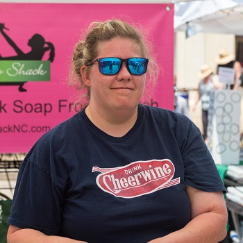 A vendor poses in sunglasses at the 2019 Cheerwine Festival