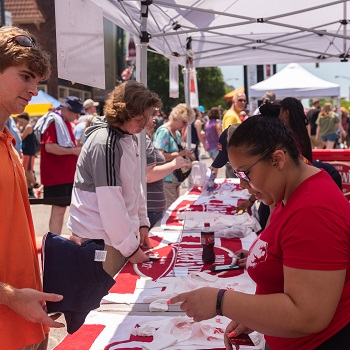 Cheerwine staff working at the merchandise table at the 2019 Cheerwine Festival