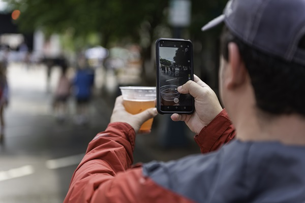 Man uploading picture of beer during Cheerwine Festival